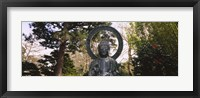 Framed Statue of Buddha in a park, Japanese Tea Garden, Golden Gate Park, San Francisco, California, USA