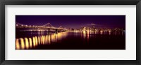 Framed Bridge lit up at night, Bay Bridge, San Francisco Bay, San Francisco, California