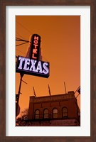 Framed Low angle view of a neon sign of a hotel lit up at dusk, Fort Worth Stockyards, Fort Worth, Texas, USA