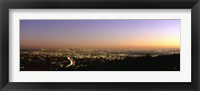 Framed Aerial view of buildings in a city at dusk from Hollywood Hills, Hollywood, City of Los Angeles, California, USA
