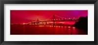 Framed Suspension bridge lit up at night, Bay Bridge, San Francisco, California, USA