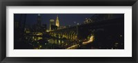Framed Arch bridge and buildings lit up at night, Cleveland, Ohio, USA