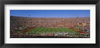 Framed High angle view of a football stadium full of spectators, Los Angeles Memorial Coliseum, City of Los Angeles, California, USA