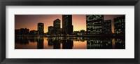 Framed Buildings lit up at dusk, Oakland, Alameda County, California, USA