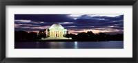 Framed Monument lit up at dusk, Jefferson Memorial, Washington DC, USA
