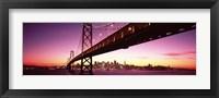 Framed Bay Bridge and city skyline at night, San Francisco, California, USA