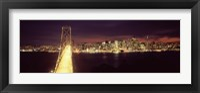 Framed Bay Bridge and San Francisco skyline at night, California