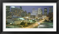 Framed Skyscrapers lit up at night, Houston, Texas