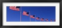 Framed Low angle view of American flags, Washington Monument, Washington DC, USA