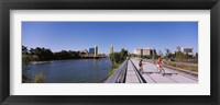 Framed Bicyclists along the Sacramento River with Tower Bridge in background, Sacramento, Sacramento County, California, USA