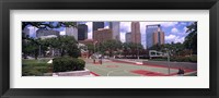 Framed Basketball court with skyscrapers in the background, Houston, Texas