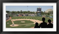Framed Spectator watching a baseball match at stadium, Raley Field, West Sacramento, Yolo County, California, USA