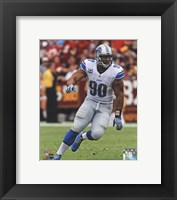 Framed Ndamukong Suh 2013 in action