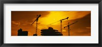 Framed Silhouette of cranes at a construction site, London, England