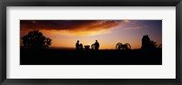 Framed Silhouette of statues of soldiers and cannons in a field, Gettysburg National Military Park, Pennsylvania, USA
