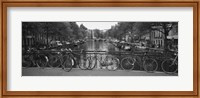Framed Bicycle Leaning Against A Metal Railing On A Bridge, Amsterdam, Netherlands