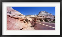 Framed Two people cycling on the road, Zion National Park, Utah, USA