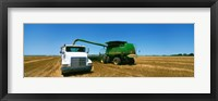 Framed Combine in a wheat field, Kearney County, Nebraska, USA