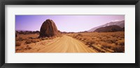 Framed Dirt road passing through an arid landscape, Californian Sierra Nevada, California, USA