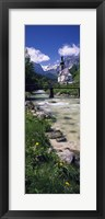 Framed Bridge over stream below country church, Bavarian Alps, Germany.
