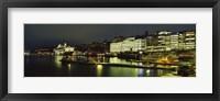 Framed Buildings in a city lit up at night, Sodermalm, Slussplan, Stockholm, Sweden