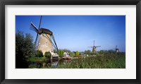 Framed Traditional windmills in a field, Netherlands