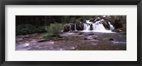 Framed Waterfall in a forest, US Glacier National Park, Montana, USA