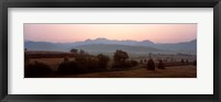 Framed Agricultural field with a mountain range in the background, Transylvania, Romania