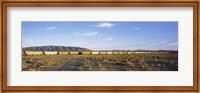 Framed Freight train in a desert, Trona, San Bernardino County, California, USA