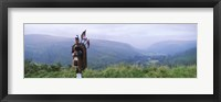 Framed Bagpiper at Loch Broom in Scottish highlands, Ross and Cromarty, Scotland