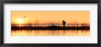 Framed Silhouette of a man fishing