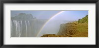 Framed Rainbow form in the spray created by the water cascading over the Victoria Falls, Zimbabwe