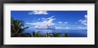 Framed Indian ocean with palm trees towards Mahe Island looking from North Island, Seychelles