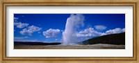 Framed Old Faithful, Yellowstone National Park, Wyoming, USA