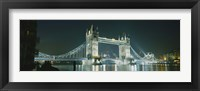 Framed Low angle view of a bridge lit up at night, Tower Bridge, London, England