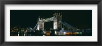 Framed Bridge lit up at night, Tower Bridge, London, England