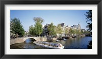 Framed Netherlands, Amsterdam, tour boat in channel