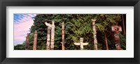 Framed Totem poles in a park, Stanley Park, Vancouver, British Columbia, Canada
