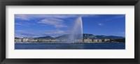 Framed Fountain in front of buildings, Jet D'eau, Geneva, Switzerland