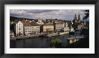 Framed High angle view of buildings along a river, River Limmat, Zurich, Switzerland