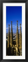 Framed High Section View Of Towers Of A Basilica, Sagrada Familia, Barcelona, Catalonia, Spain
