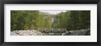Framed Wooden footbridge across a stream in a mountain range, Switzerland