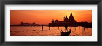 Framed Silhouette of a person on a gondola with a church in background, Santa Maria Della Salute, Grand Canal, Venice, Italy