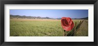 Framed USA, California, Red cowboy hat hanging on the fence