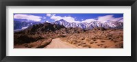Framed Dirt road passing through an arid landscape, Lone Pine, Californian Sierra Nevada, California, USA