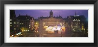 Framed High angle view of a town square lit up at dusk, Dam Square, Amsterdam, Netherlands