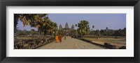 Framed Two monks walking in front of an old temple, Angkor Wat, Siem Reap, Cambodia