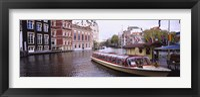 Framed Tourboat in a channel, Amsterdam, Netherlands