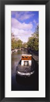 Framed Tourboat docked in a channel, Amsterdam, Netherlands