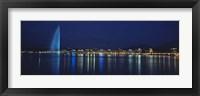 Framed Buildings lit up at night, Jet D'eau, Lake Geneva, Lausanne, Switzerland